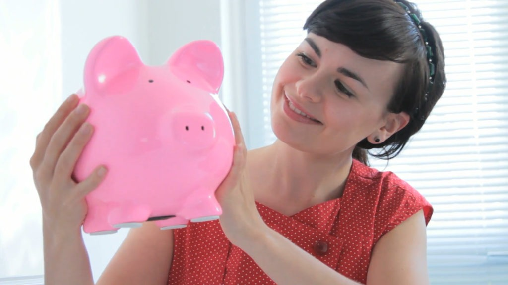 Woman with Piggibank